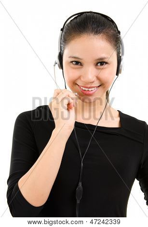 Telemarketing headset woman from call center smiling happy talking in hands free headset device. Beautiful mixed race Southeast Asian / Caucasian business woman isolated on white background.