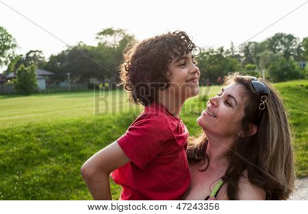 Single Mother And Her Child In A Park