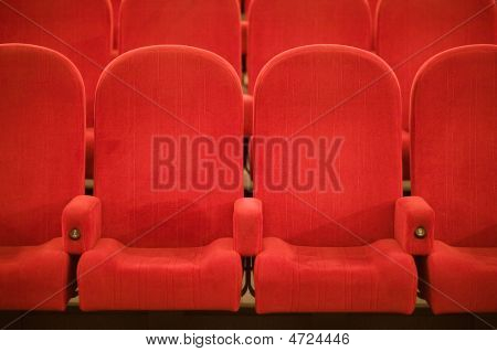 Empty Cinema Auditorium With Red Chairs