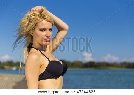 Blonde sexy girl on the beach
