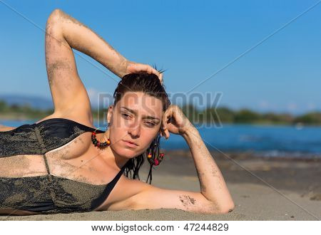 Beautiful girl laying on the beach