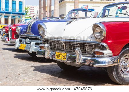 HAVANA-JUNE 21:Classic Ford and other vintage american cars on June 21, 2013 in Havana.These classic cars are a worldwide famous sight and a tourist attraction of the island