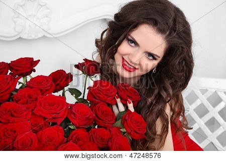 Coquette Girl. Beautiful Happy Woman With Bouquet Of Many Red Roses Flowers At Interior Apartment, V