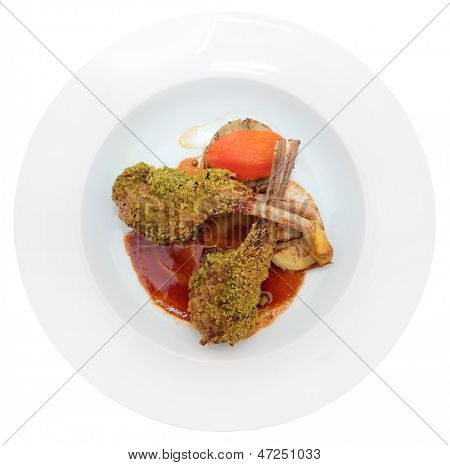 Grilled rack of lamb with pistachio in plate, isolated on white background
