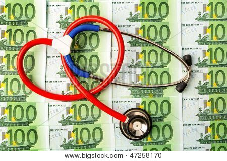 stethoscope and euro bills. symbol photo for costs in health care and health insurance and medical