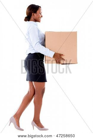 Business woman carrying a cardboard box - isolated over white