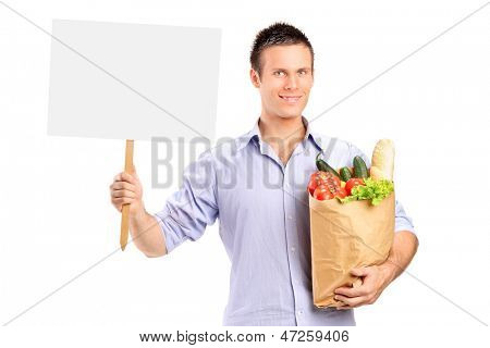 Male holding a paper bag and blank panel isolated on white background