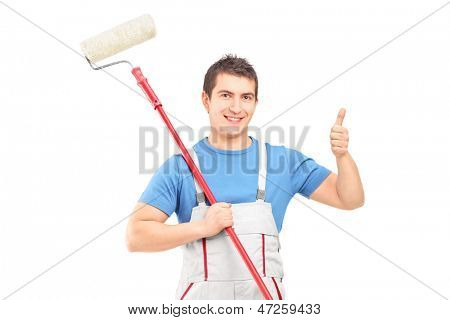 Male painter holding a roller and giving a thumb up isolated on white background
