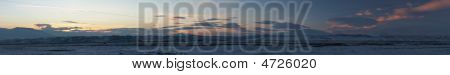 Panoramic Image Of Winter Sunset In Mountains