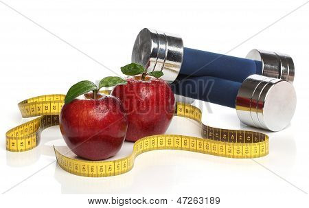 Red apples and a measuring tape over white