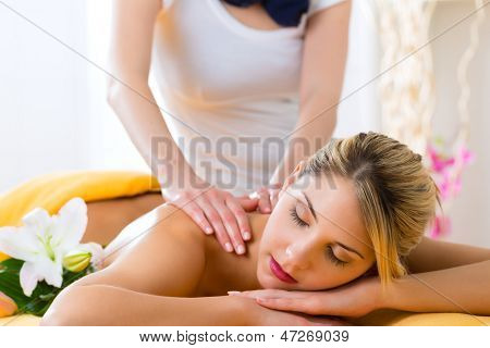 Wellness - woman receiving body or back massage in spa