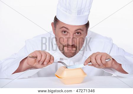 Chef eating a polystyrene foam takeaway box