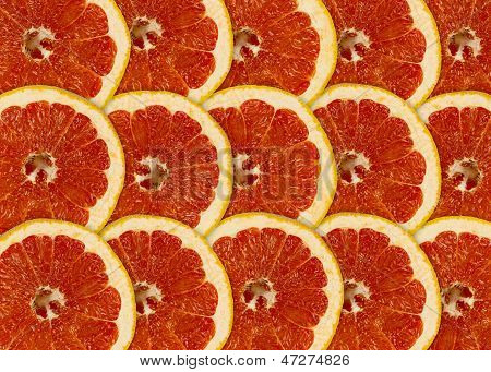 Abstract Red Background With Citrus-fruit Of Grapefruit Slices