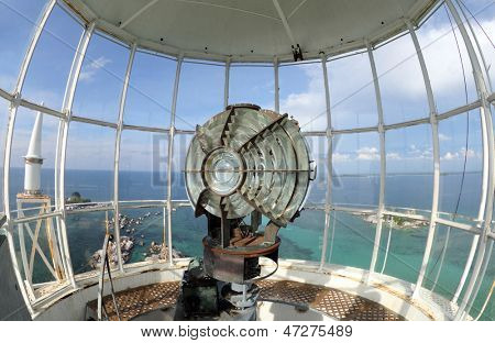 Lamp in the lighthouse room. Large fresnel lens of lighthouse beacon