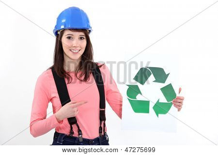 Craftswoman showing recycling logo