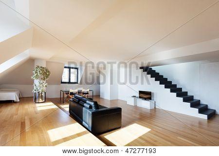 Interior, wide loft, hardwood floor, view living room