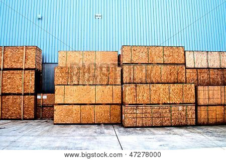 Wooden boxes for transportation and a blue cladding in a warehouse