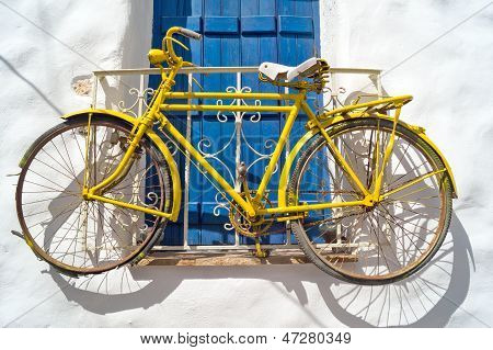 Decorative Bicycle Hanging From A Window In A Greek House On Naxos Island, Greece