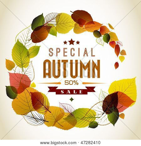 Autumn abstract floral background - circle from colorful leafs with sample text