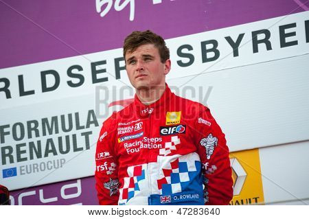 MOSCOW - JUNE 23: Oliver Rowland of Manor MP Motorsport team (NED) gets a reward for winning at Formula Renault 2.0 race at World Series by Renault in Moscow Raceway on June 23, 2013 in Moscow