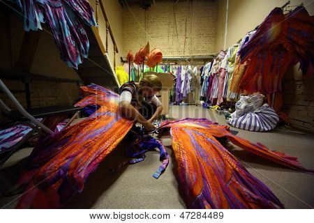 MOSCOW - SEP 19: A girl prepares costumes before rehearsal of the musical The Little Mermaid in the theater Russia on September 19, 2012 in Moscow, Russia.