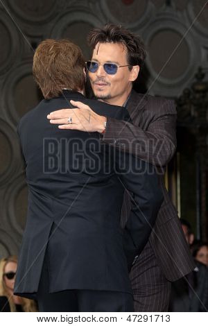 LOS ANGELES - JUN 24:  Jerry Bruckheimer, Johnny Depp at  the Jerry Bruckheimer Star on the Hollywood Walk of Fame  at the El Capitan Theater on June 24, 2013 in Los Angeles, CA