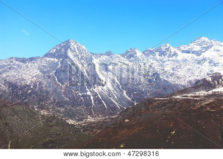 Top of High mountains covered by snow