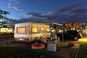 image of caravan  - Caravan on a camping site at night - JPG