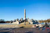 OSLO NORWAY- JANUARY 1: Visitors enjoying the statues created by Gustav Vigeland in the popular Vige