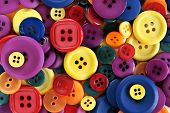 picture of tailoring  - Pile of brightly colored buttons used in sewing and haberdashery - JPG