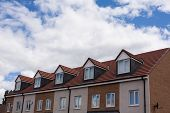 image of gabled dormer window  - Gable dormers and roof of residential house - JPG