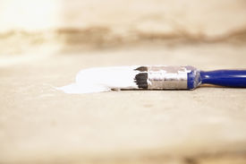 image of tarp  - Closeup of paintbrush on painting tarp - JPG