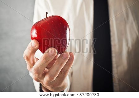 Businessman Holding Red Apple