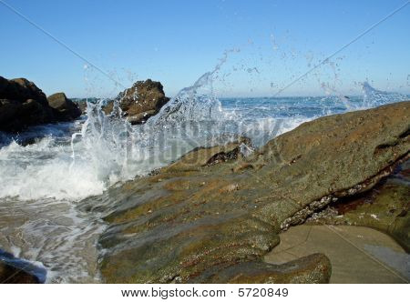 Waves Splashing over Rocks