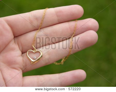 Hand With Gold Heart Pendant