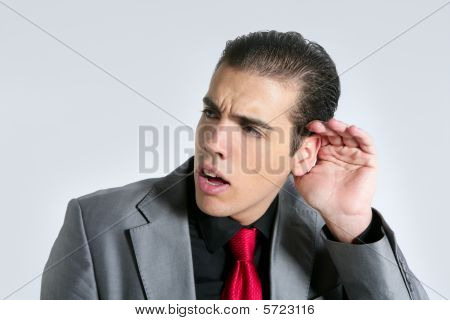 Businessman With Hand In Ear As A Deafness Sign