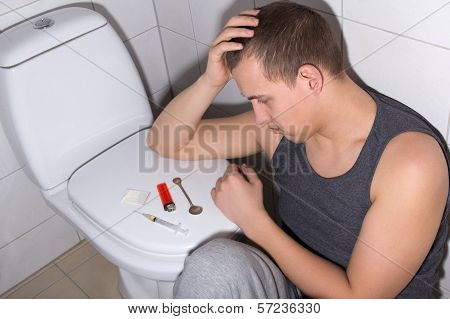 Stoned Man With Heroin Addiction In Bathroom