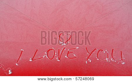 I love you text on frozen window