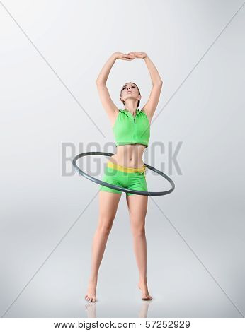 Young Woman Rotating Hula Hoop