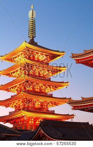Japanese red pagoda at twilight from The sensoji Buddhist Temple , Asakusa Tokyo