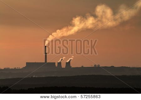 The Silhouette Of Coal Plant With Thick Smog