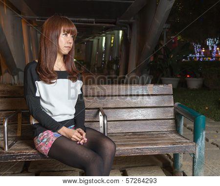 Sad Asian Woman On A Park Bench