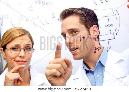 Two Scientists Working Out A Problem