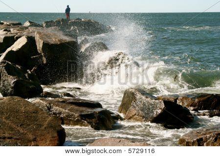 Ocean spray over rocky shoreline