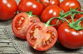 picture of market segmentation  - Fresh red tomatoes on a wooden and jute background - JPG