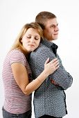 image of atonement  - young woman hugging man from the back - JPG