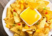 pic of nachos  - nachos with cheese on a wooden table - JPG
