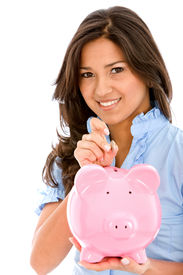 stock photo of save money  - Woman saving money in a piggy bank isolated - JPG