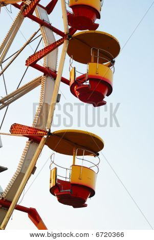 Close Ferris Wheel At Dusk In Autumn