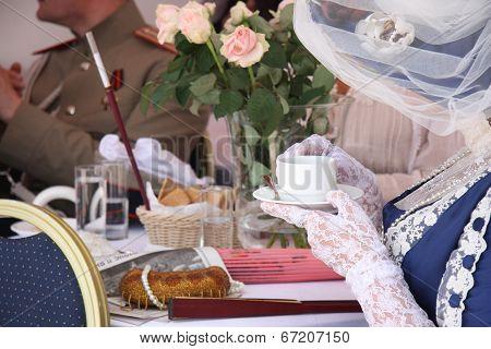 People in vintage restaurant drinking tea